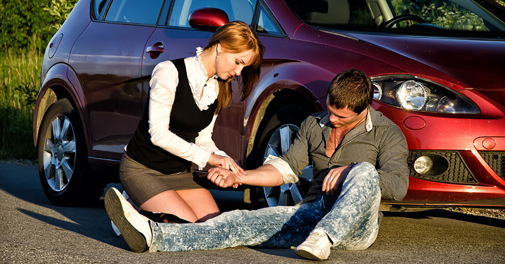women giving first aid after driving